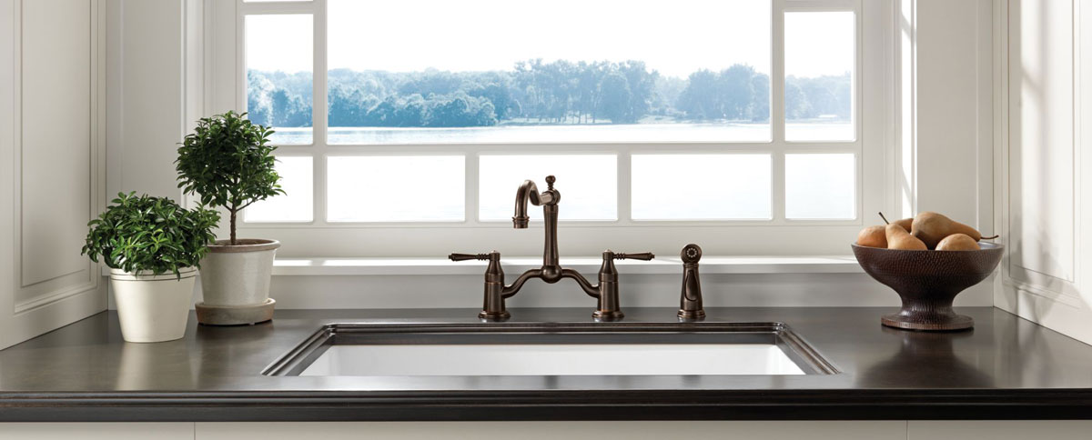 Two handled bronze type kitchen faucet with spray nozzle